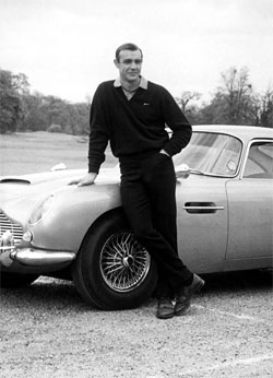 Bond, still in golf shoes after winning his match with Goldfinger