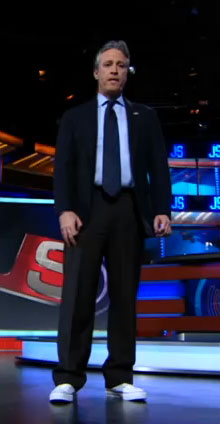 Ask the MB: Jon Stewart Rocking Suit with Sneakers